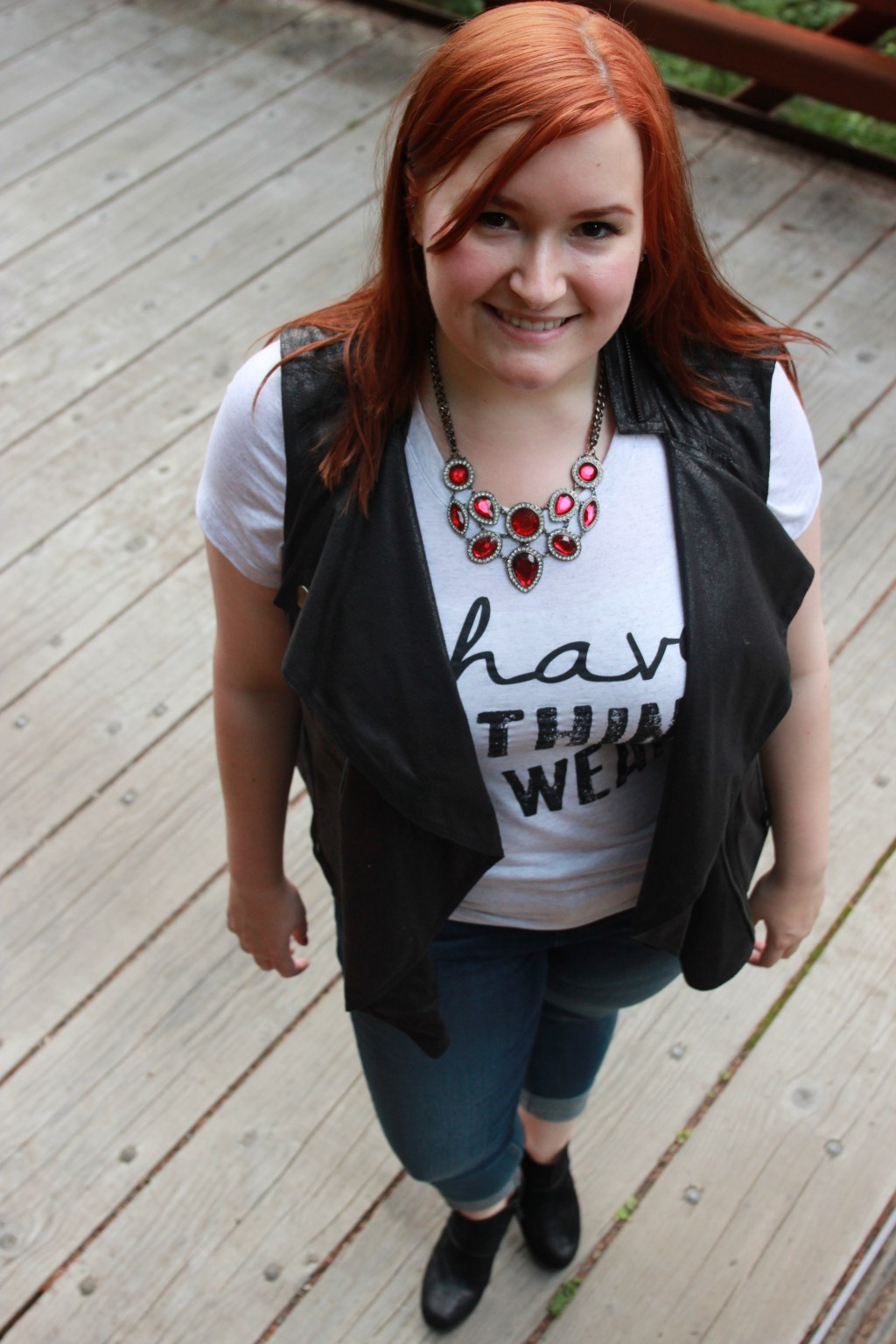 Styling cropped jeans, booties, and a motorcycle vest