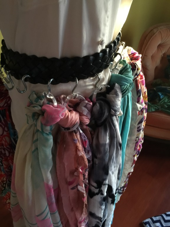 Using a belt, S hooks, and shower curtain rings to organize scarves