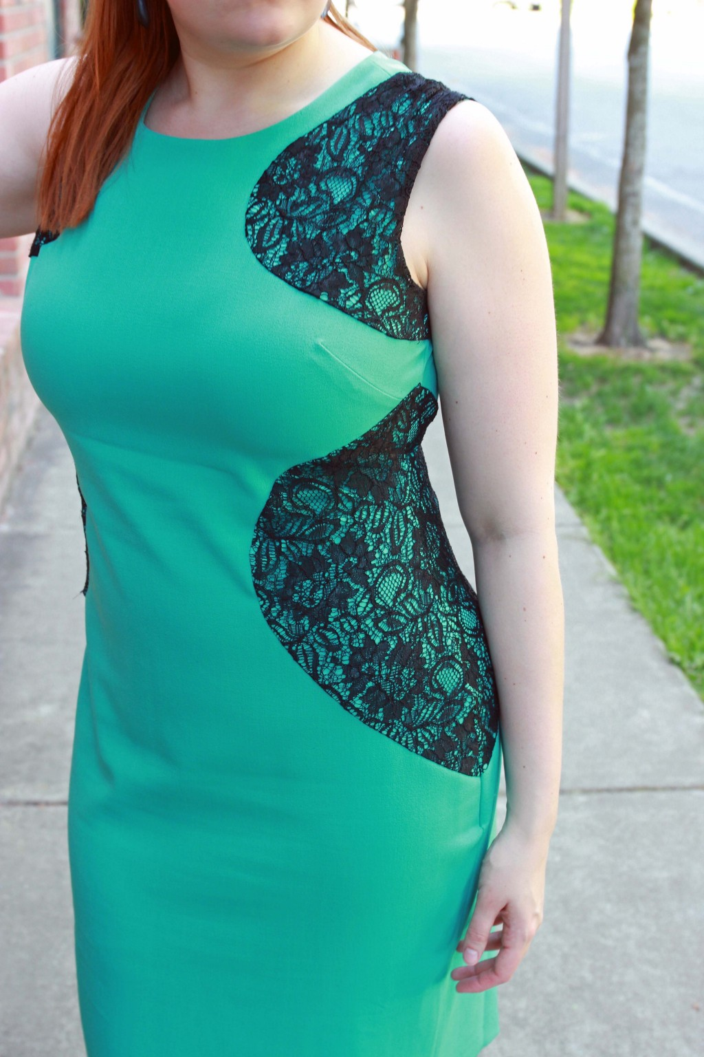 Green bodycon dress with lace panel side detail