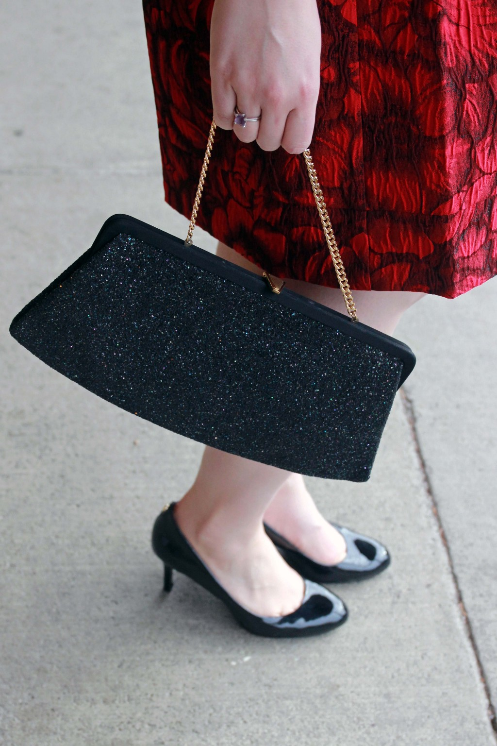 Vintage clutch and black heels accessories