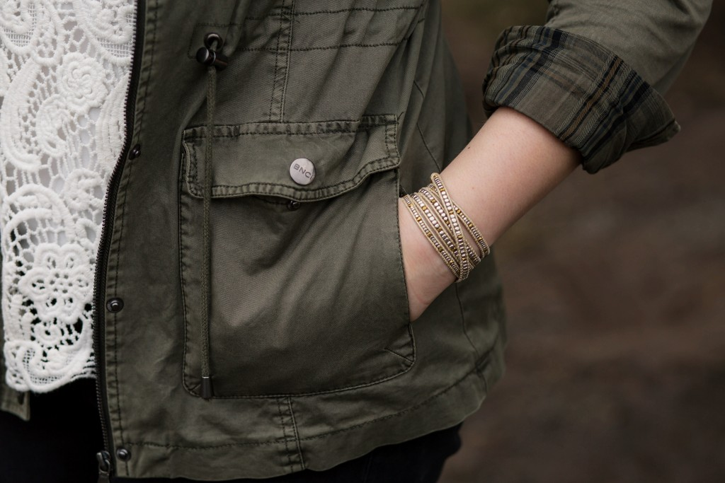 9 - gold beaded bracelet army green jacke